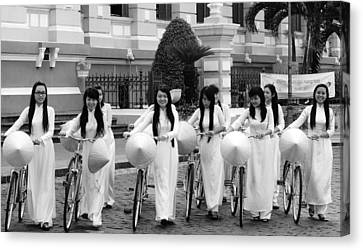 Canvas Print featuring the photograph Girls-bicycle by Arik S Mintorogo