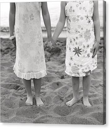 Girls Holding Hand On Beach Canvas Print by Michelle Quance