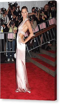 Gisele Bundchen Wearing A Versace Gown Canvas Print by Everett