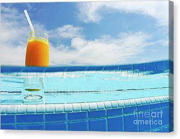 Glass Of Orange Juice On Pool Ledge Canvas Print by Sami Sarkis