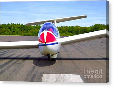 Glider On A Runway Canvas Print by Richard Thomas