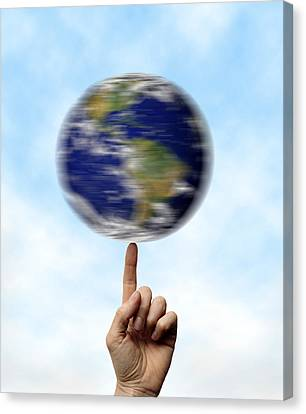Globe Spinning On A Finger Canvas Print by Cordelia Molloy
