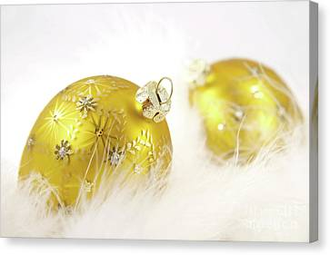 Gold Balls With Feathers Canvas Print by Sandra Cunningham