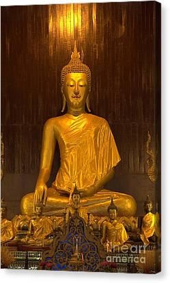 Golden Buddha Statue  Canvas Print by Anek Suwannaphoom
