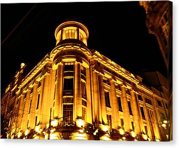Canvas Print featuring the photograph Golden Building At Night by Kirsten Giving