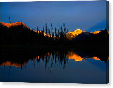 Golden Sunrise With Blue Background On Vermillion Lake Canvas Print by Hegde Photos