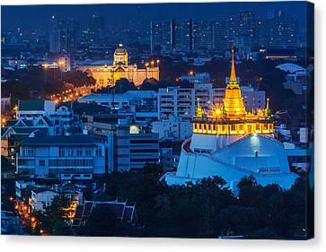 Golden Temple Bangkok Night Canvas Print by Arthit Somsakul