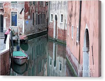 Gondolier Overlooking Rio De S. Anzolo Venice Italy Canvas Print by Julia Hiebaum