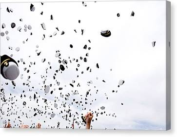 Graduates Toss Their Hats Into The Air Canvas Print