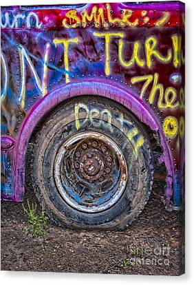 Graffiti Bus Wheel Canvas Print by Susan Candelario