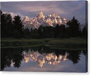 Grand Teton Range And Cloudy Sky Canvas Print by Tim Fitzharris