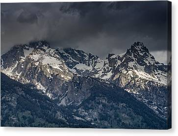 Grand Tetons Immersed In Clouds Canvas Print by Greg Nyquist
