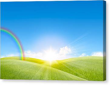 Grassland In The Sunny Day With Rainbow Canvas Print by Setsiri Silapasuwanchai