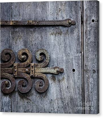 Canvas Print featuring the photograph Gray Wooden Doors With Ornamental Hinge by Agnieszka Kubica