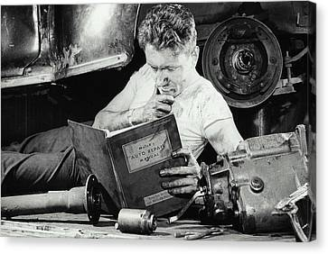Greasy Mechanic On Garage Floor, Manual Canvas Print by Archive Holdings Inc.