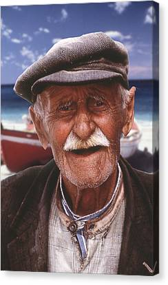 Greek Fisherman Canvas Print by Ron Schwager