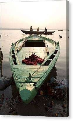 Green Stationary Boat At Waters Edge Canvas Print by David DuChemin
