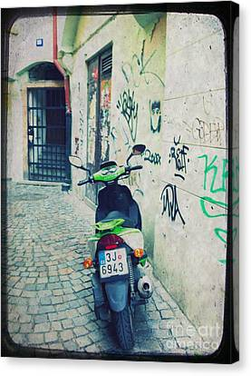 Green Vespa In Prague Canvas Print by Linda Woods