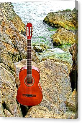 Guitar By The Sea Canvas Print by Jason Abando