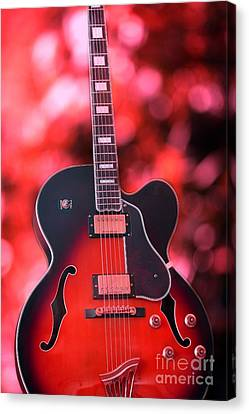 Guitar In Red Canvas Print by Sophie Vigneault