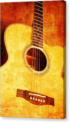 Guitar On Old  Wall Canvas Print by Nattapon Wongwean