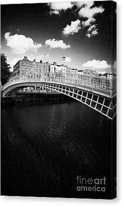 Halfpenny Bridge Canvas Print - Halfpenny Hapenny Bridge Over The River Liffey In The Centre Of Dublin City Ireland by Joe Fox