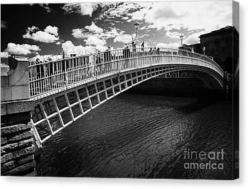 Halfpenny Bridge Canvas Print - Halfpenny Hapenny Bridge Over The River Liffey In The Centre Of Dublin City Republic Of Ireland  by Joe Fox