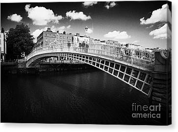 Halfpenny Bridge Canvas Print - Halfpenny Hapenny Bridge Over The River Liffey In The Centre Of Dublin Ireland by Joe Fox