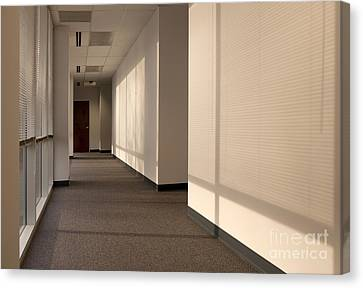 Hallway Of An Office Building Canvas Print by Will & Deni McIntyre