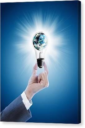 Hand Holding Light Bulb With Globe  Canvas Print
