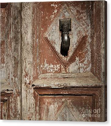 Canvas Print featuring the photograph Hand Knocker And Weathered Wooden Doors by Agnieszka Kubica