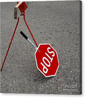 Handheld Stop Sign Canvas Print by Marlene Ford