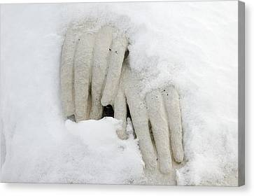 Hands Of A Statue Covered With Snow Canvas Print by Matthias Hauser