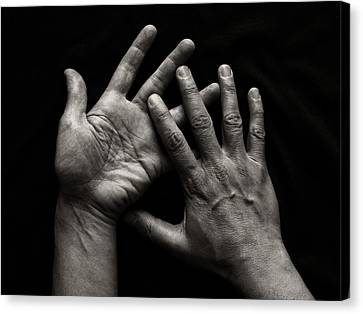 Hands On Black Background Canvas Print