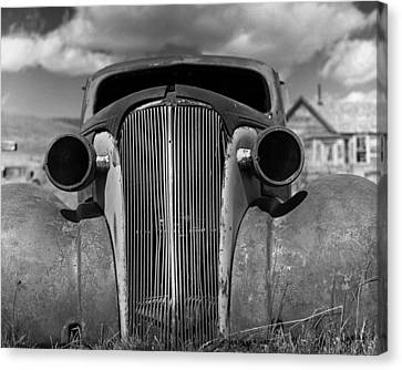 Headlights And Grill With Clouds Canvas Print