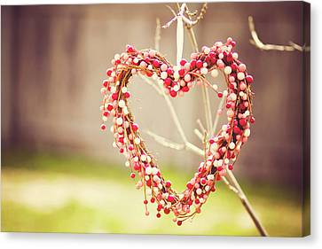 Heart Wreath Hanging On Tree Canvas Print