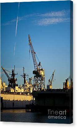 Heavy Equipment Cranes At Drydock Canvas Print by Eddy Joaquim