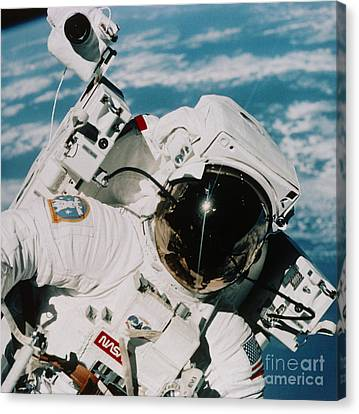 Helmet Of Astronaut Mccandless Canvas Print by NASA / Science Source