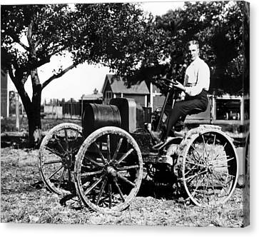 Henry Ford At The Controls Of One Canvas Print by Everett