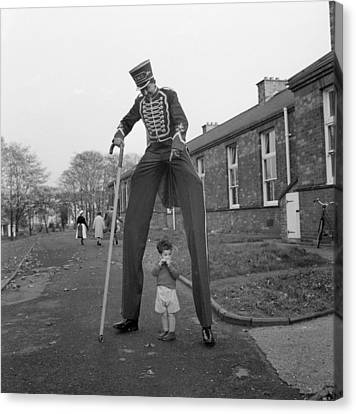 Henry The Stilt Man Canvas Print by John Drysdale