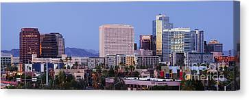 High Rise Buildings Of Downtown Phoenix At Sunrise Canvas Print by Jeremy Woodhouse