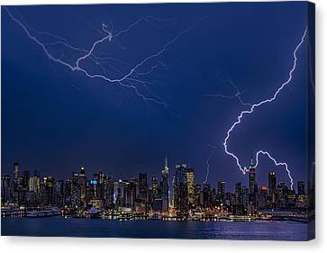 High Voltage In The  New York City Skyline Canvas Print by Susan Candelario