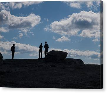 Hikers On Cliff Top Canvas Print by Jim DeLillo