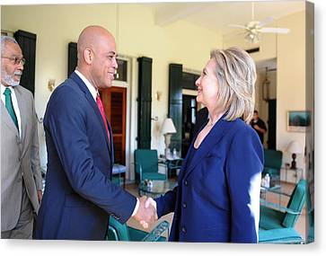 Hillary Clinton Meets With Haitian Canvas Print by Everett