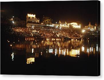 Hindus Line The Ghat At Night To Float Canvas Print