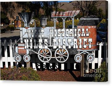 Historic Niles District In California Near Fremont . Visit Historical Niles District Sign . 7d10653 Canvas Print by Wingsdomain Art and Photography