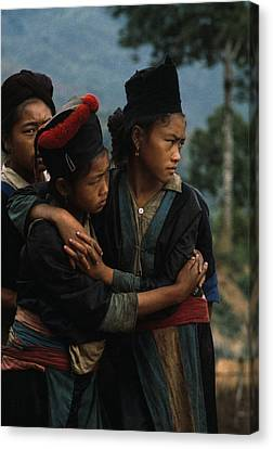 Hmong Girls Cling To Each Other Canvas Print by W.E. Garrett