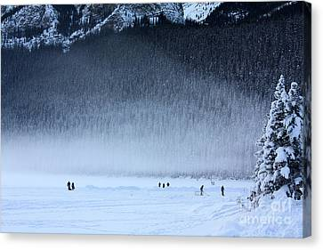 Hockey On Lake Louise Canvas Print by Alyce Taylor
