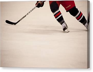 Hockey Stride Canvas Print by Karol Livote