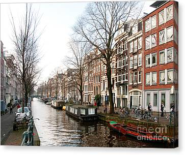 Homes Along The Canal In Amsterdam Canvas Print by Carol Ailles